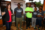 (L-R) Regina Borda of Taco Bell for Foundation for Teens, Detroit Lions running back Reggie Bush and Boys & Girls Club of America members attend the Touchdown For Teens Campaign at Taco Bell on August 26, 2014 in Royal Oak, Michigan.