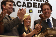 2013 British Open golf champion Phil Mickelson (R), and his wife Amy bang the gavel at the closing bell of the New York Stock Exchange on July 26, 2013 in New York City. The American golfer was there to promote his ExxonMobile Teachers Academy charity.