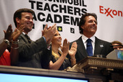2013 British Open golf champion Phil Mickelson (R), and his wife Amy Mickelson applaud the closing bell of the New York Stock Exchange on July 26, 2013 in New York City. The American golfer was there to promote his ExxonMobile Teachers Academy charity.