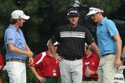 Webb Simpson, Bubba Watson and Keegan Bradley chat on the 10th tee box during Round Two of the 2012 Travelers Championship at TPC River Highlands on June 22, 2012 in Cromwell, Connecticut.