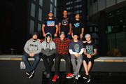 Nitro Circus riders (back row l-r) Dov Rybnik, Jed Mildon, Josh Sheehan and (front row l-r) Beau Bamburg, Jarryd McNeil, Travis Pastrana, Erik Roner and Jaie Toohey pose for a photo prior to their Nitro Circus Live Show in Manchester on November 26, 2013 in Manchester, England.