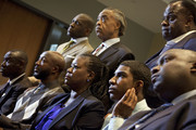 Parents of Trayvon Martin who was fatally shot by neighborhood watch captain George Zimmerman in Florida, mother Sybrina Fulton (C), Tracy Martin (Center L) hold hands as they watch a news conference from Washington, with special prosecutor Angela Corey in Sanford, Fla. announcing charges against George Zimmerman April 11, 2012 in Washington, DC.  Along with the parents are family lawyer Benjamin Crump (L), Trayvon Martin's brother Jahvaris Fulton (2nd R) and family lawyer Daryl Park (R). Top Row (L-R) W. Franklyn Richardson, Rev. Al Sharpton and Rev Jamal Bryant are also in attendance. It has been reported that Zimmerman will be charged in the Trayvon Martin shooting according to Florida special prosecutor Angela Corey.