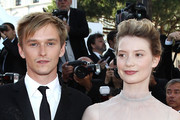 """Actor Henry Hopper (L) and actress Mia Wasikowska attend """"The Tree Of Life"""" premiere during the 64th Annual Cannes Film Festival at Palais des Festivals on May 16, 2011 in Cannes, France."""