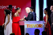 Janet Mock (L) presents the Hero Award to Ryan Murphy onstage during the Trevor Project's TrevorLIVE LA 2018 at The Beverly Hilton Hotel on December 3, 2018 in Beverly Hills, California.