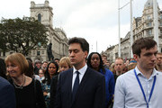 (L-R) Former Labour Leader Ed Miliband (C) and former deputy Leader of the Labour Party Harriet Harman (L) attend a vigil in memory of Labour MP Jo Cox on Parliament Square on June 17, 2016 in London, England. The Labour MP for Batley and Spen was about to hold her weekly constituency surgery in Birstall Library yesterday when she was shot and stabbed in the street on June 16. A 52-year old man is being held in Police custody in connection with the death.