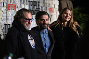 """(L-R) Julian Schnabel, Oscar Isaac and Louise Kugelberg attend the """"Triple Frontier"""" World Premiere at Jazz at Lincoln Center on March 03, 2019 in New York City."""