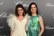 Calu Rivero (L) and Livia Firth attend the Trophee Chopard during the 71st annual Cannes Film Festival at Hotel Martinez on May 14, 2018 in Cannes, France.