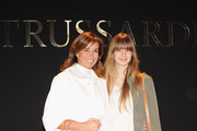 Cristina Parodi and her daughter Benedetta attend the Trussardi show as part of Milan Fashion Week Womenswear Autumn/Winter 2014 on February 23, 2014 in Milan, Italy.