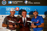 Lee Westwood of England and Sergio Garcia of Spain are presented with a model aeroplane by Ahmet Agaoglu, President of the Turkish Golf Federation ahead of the Turkish Airlines Open at The Montgomerie Maxx Royal on November 12, 2014 in Antalya, Turkey.