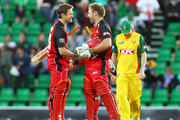 (L to R) Daniel Harris and Aiden Blizzard of the Redbacks celebrate winning the Twenty20 Big Bash match between the Tasmanian Tigers and the South Australian Redbacks at Bellerive Oval on January 24, 2011 in Hobart, Australia.