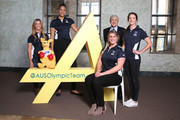 Athletes (L-R) Torah Bright, Liz Cambage, Holly Lincoln-Smith and Alicia Quirk pose with Kerry Stokes, Chairman of Seven West Media, during the Two Years To Go countdown ahead of the 2016 Rio Olympic Games at Museum of Contemporary Art on August 5, 2014 in Sydney, Australia.