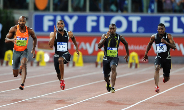 Tyson Gay of United States (2ndL) competes ahead of Asafa Powell of Jamaica ...