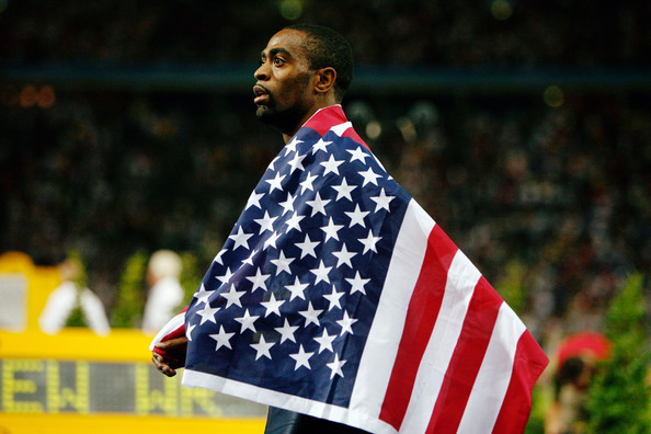12th IAAF World Athletics Championships - Day Two [flag,flag of the united states,stadium,competition event,sport venue,world,team,player,men,tyson gay,silver medal,united states,olympic stadium,berlin,germany,iaaf world athletics championships]