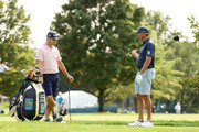 (L-R) Gary Woodland of the United States talks with Matt Kuchar of the United States on a tee during a practice round prior to the 120th U.S. Open Championship on September 15, 2020 at Winged Foot Golf Club in Mamaroneck, New York.