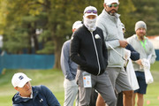 Jordan Spieth (L) of the United States plays a shot from the rough as caddie Michael Greller (2nd R) looks on during a practice round prior to the 120th U.S. Open Championship on September 15, 2020 at Winged Foot Golf Club in Mamaroneck, New York.