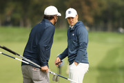 Jordan Spieth (R) of the United States talks with caddie Michael Greller (L) during a practice round prior to the 120th U.S. Open Championship on September 15, 2020 at Winged Foot Golf Club in Mamaroneck, New York.