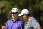 Justin Rose of England chats with his caddie Mark Fulcher during a practice round prior to the start of the 114th U.S. Open at Pinehurst Resort & Country Club, Course No. 2 on June 11, 2014 in Pinehurst, North Carolina.
