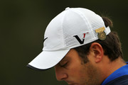 Francesco Molinari of Italy looks over his yardage book on the second hole during the first round of the 110th U.S. Open at Pebble Beach Golf Links on June 17, 2010 in Pebble Beach, California.