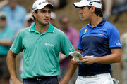 Edoardo Molinari (L) and Matteo Manassero of Italy wait on a green during the first round of the 111th U.S. Open at Congressional Country Club on June 16, 2011 in Bethesda, Maryland.