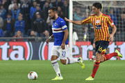 Fabio Quagliarella of UC Sampdoria and Biagio Meccariello of US Lecce compete for the ball during the Serie A match between UC Sampdoria and US Lecce at Stadio Luigi Ferraris on October 30, 2019 in Genoa, Italy.