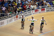 (l to r) Alexander Edmondson, Glenn O'Shea and Mitchell Mulhern of Australia celebrate winning the Men's Team Pursuit title during day one of the 2014 UCI Track Cycling World Championships on February 26, 2014 in Cali, Colombia.