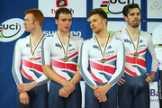 Ed Clancy, Steven Burke, Owain Doull and Andrew Tennant of the Great Britain Cycling Team look on after receiving their silver medals after the Men's Team Pursuit Final during day two of the UCI Track Cycling World Championships at the National Velodrome on February 19, 2015 in Paris, France.
