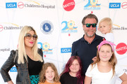 "(L-R) Tori Spelling, Finn Davey McDermott, Hattie Margaret McDermott, Dean McDermott, Stella Doreen McDermott and Beau Dean McDermott attend UCLA Mattel Children's Hospital's 20th Annual ""Party on the Pier"" at Pacific Park – Santa Monica Pier on November 03, 2019 in Santa Monica, California."
