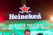 Heineken Ambassador Ruud Van Nistelrooy, left, stands on stage with a fan during the UEFA Champions League Trophy Tour presented by Heineken on April 4, 2018 in Phnom Penh, Cambodia.