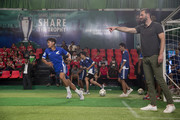 Heinekenn Ambassador Ruud Van Nistelrooy, right, addresses Cambodian football players during the UEFA Champions League Trophy Tour presented by Heinekenn on April 3, 2017 in Phnom Penh, Cambodia.