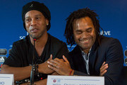 Ronaldinho, Former Brazil and Barcelona player and Christian Karembeu laughs during a press conference for Match for Solidarity on April 20, 2018 at Grand Hotel Kempinski in Geneva, Switzerland.