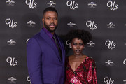 """(L-R) Winston Duke and Lupita Nyong'o attend UK exclusive screening of """"Us"""" at Picturehouse Central on March 14, 2019 in London, England."""