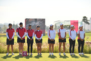 Japanese and Thailand players line up for the national anthems prior to the Pool B match between Japan and Thailand on day one of the UL International Crown at Jack Nicklaus Golf Club on October 4, 2018 in Incheon, South Korea.