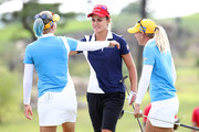 Lexi Thompson (C) of the United States is congratulated by Pernilla Lindberg (R) and Madelene Sagstrom (L) of Sweden after the Pool B match between United States and Sweden on day one of the UL International Crown at Jack Nicklaus Golf Club on October 4, 2018 in Incheon, South Korea.