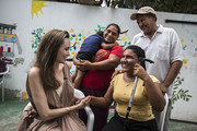 (EDITORIAL USE ONLY) In this handout image provided by United Nations High Commission for Refugees, UNHCR Special Envoy Angelina Jolie meets with Ester Barboza, 17, in Riohacha, Colombia. Barboza has been blind since age three and fled Venezuela with her family due to lack of medical care.