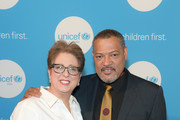 President & CEO Caryl Stern and Actor Laurence Fishburne attend UNICEF's Evening For Children First at The Foundry At Puritan Mill on March 17, 2017 in Atlanta, Georgia.