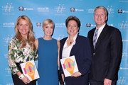 (L-R) CEO of the Home Shopping Network Mindy Grossman, UNICEF author Hilary Gumbel, President and CEO of the US Fund for UNICEF Caryl M. Stern and President of Home Shopping Network Bill Brand attend UNICHEF Book Party at The Lamb's Club on September 15, 2014 in New York City.
