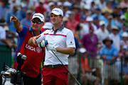 Justin Rose of England chats with his caddie Mark Fulcher on the seventh tee during the second round of the 114th U.S. Open at Pinehurst Resort & Country Club, Course No. 2 on June 13, 2014 in Pinehurst, North Carolina.