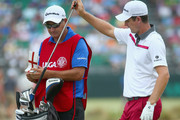 Justin Rose of England pulls a club on the 12th hole alongside caddie Mark Fulcher during the second round of the 114th U.S. Open at Pinehurst Resort & Country Club, Course No. 2 on June 13, 2014 in Pinehurst, North Carolina.