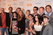 "Actor Ed O'Neill, executive producer Chris Lloyd, actors Sarah Hyland, Eric Stonestreet, Sofia Vergara, Julie Bowen, Ty BUrrell, Rico Rodriguez, Jesse Tyler Ferguson, Ariel Winter, executive producer Steve Levitan and actor Nolan Gould attend USA Network's ""Modern Family"" fan appreciation day at Westwood Village on October 28, 2013 in Los Angeles, California."