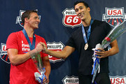 (L-R) Ryan Lochte congratulates Eugene Godsoe for winning the men's 100m butterfly finals on day 3 of the 2013 USA Swimming Phillips 66 National Championships and World Trials at the Indiana University Natatorium on June 27, 2013 in Indianapolis, Indiana.