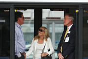 Phil Mickelson of the United States and wife Amy Mickelson talk to Kerry Haigh, PGA of America Chief Championships Officer as they wait for the United States team to arrive at Edinburgh Airport ahead of the 2014 Ryder Cup at Gleneagles on September 22, 2014 in Edinburgh, Scotland.