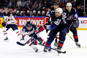 Alec Martinez (R) of the United States and Brayden Schenn of Canada battle for the puck during the 2018 IIHF Ice Hockey World Championship Bronze Medal Game game between the United States and Canada at Royal Arena on May 20, 2018 in Copenhagen, Denmark.
