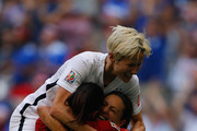 Carli Lloyd #10 of the United States of America celebrates after her third goal against Japan with goalkeeper Hope Solo #1 and Megan Rapinoe #15 in the FIFA Women's World Cup Canada 2015 Final at BC Place Stadium on July 5, 2015 in Vancouver, Canada.