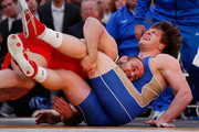 "Tervel Dlagnev of Team USA knocks Barsag Kesaev of Russia to the mat in a freestyle wrestling match during the 2011 ""Beat The Street"" Gala on May 5, 2011 in Times Square, New York City."