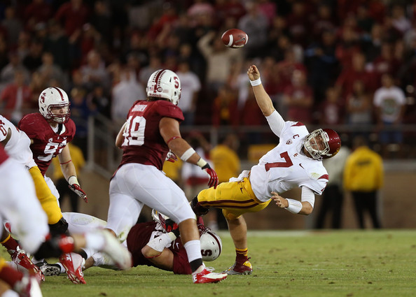 <a class='sbn-auto-link' href='http://www.sbnation.com/ncaa-football/players/78123/matt-barkley'>Matt Barkley</a> #7 of the USC Trojans tries to get a pass away after being hit during their final quarter of their game against the Stanford Cardinal at Stanford Stadium on September 15, 2012 in Palo Alto, California.