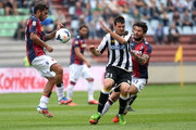Andrea Lazzari (R)  of Udinese Calcio competes with Michele Pazienza of Bologna FC during the Serie A match between Udinese Calcio and Bologna FC at Stadio Friuli on September 15, 2013 in Udine, Italy.