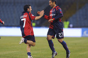 Jeda (R) of Cagliari celebrates with teammate Andrea Cossu after scoring the 1:0 goal during the Serie A match between Udinese Calcio and Cagliari Calcio at Stadio Friuli on February 24, 2010 in Udine, Italy.