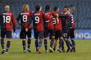 Jeda (2nd R) of Cagliari celebrates with Alessandro Agostini (3rd R) and teammates after scoring the opening goal of the Serie A match between Udinese Calcio and Cagliari Calcio at Stadio Friuli on February 24, 2010 in Udine, Italy.