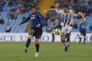 (L to R) Diego Milito of Inter competes with Aleksandar Lukovic of Udinese  during the Serie A match between Udinese and Inter at Stadio Friuli on February 28, 2010 in Udine, Italy.