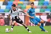 Rodrigo De Paul of Udinese Calcio  competes for the ball with Aaron Ramsey of Juventus during the Serie A match between Udinese Calcio and Juventus at Stadio Friuli on July 23, 2020 in Udine, Italy.